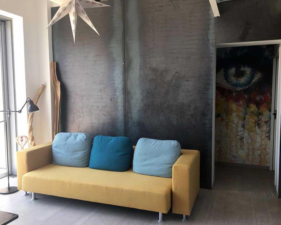 Exemple de restauration / couverture de canapé contemporain : le Canapé Arik de Cinna